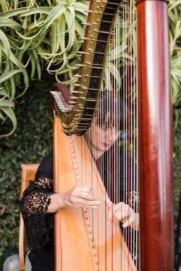 Classical harpist performing at Hotel Splendido in PortofinoWedding by SposiamoVi