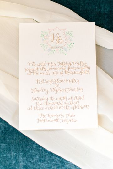 This invitation suite was designed around a custom watercolor monogram for the bride and groom. The...