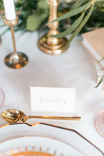 Gold calligraphy place cards decorated each guest's place setting.