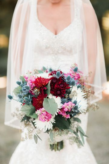 Bride holding a bouquet - Kelly Laramore Photography
