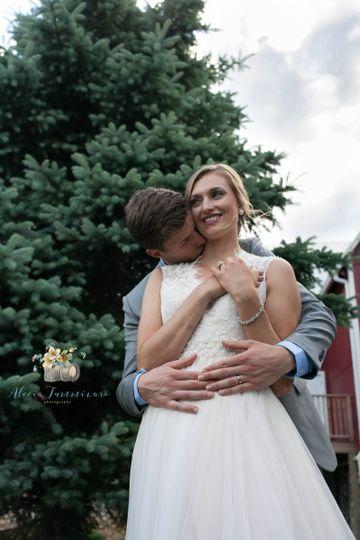 Groom-kissing-brides-neck