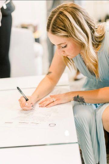 Beth Signing Wedding Cert
