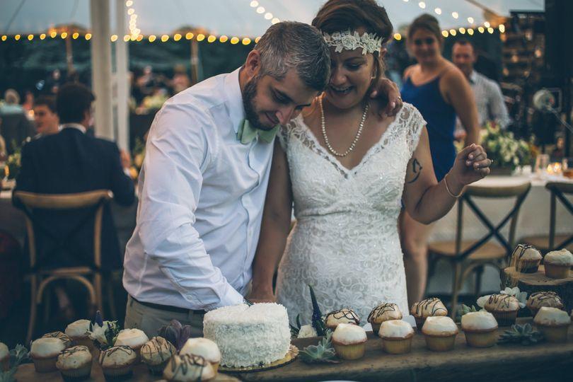 Cutting their wedding cake