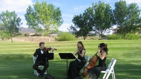 Members of the Bella Rosa Trio performing for an outdoor wedding in Las Vegas.