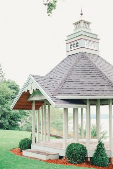The gorgeous custom-built ceremony gazebo overlooks the lake, mountains, and a private beach!