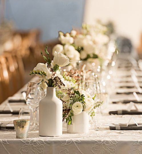 Reception table setting and floral centerpiece