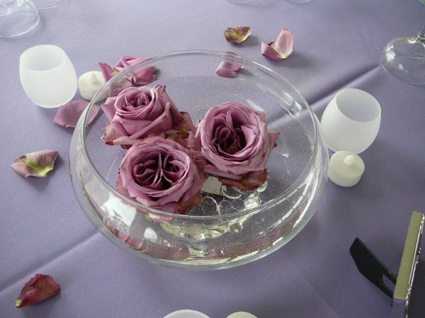 Simple table setting with floating roses and scattered petals