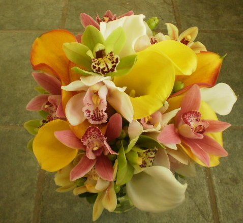Orchids in Multi Color and Beautiful Tropical Calla in Mango and Yellow create the Paradise Found...