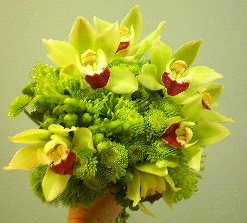 Green Orchids Button Mums and Berries Accented With Big Fuji Mums
