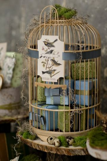 A whimsical birdcage, enclosed with favors wrapped in chic Japanese papers.