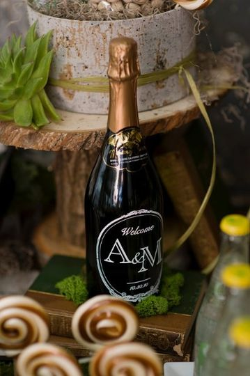 Custom engraved champagne and wine bottles for your reception tables, favors, or out-of-town guest...