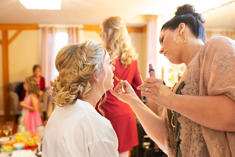 Curly hair updo getting makeup