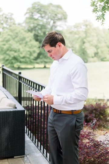 Groom reading his letter