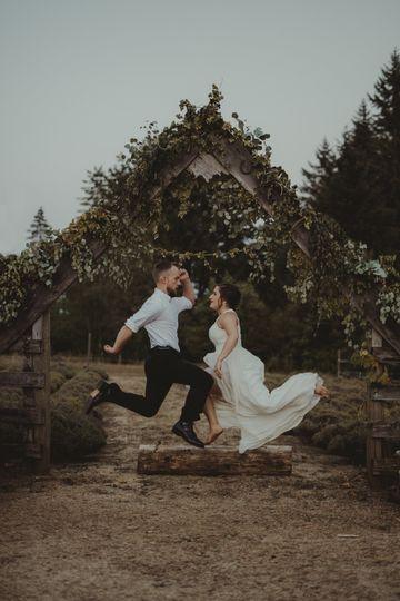 Jump shot of newlyweds