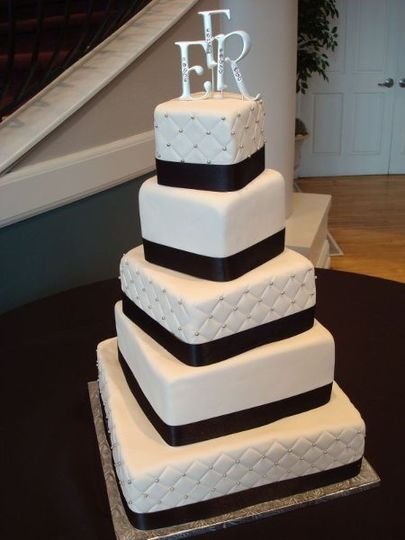 Large square rotating 5-tier with elegant modern design and monogram
