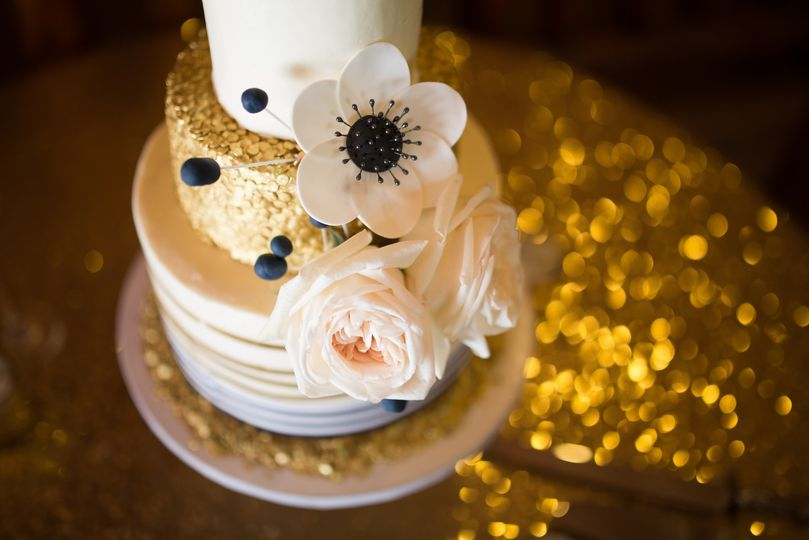 Gold confetti cake with ribbon