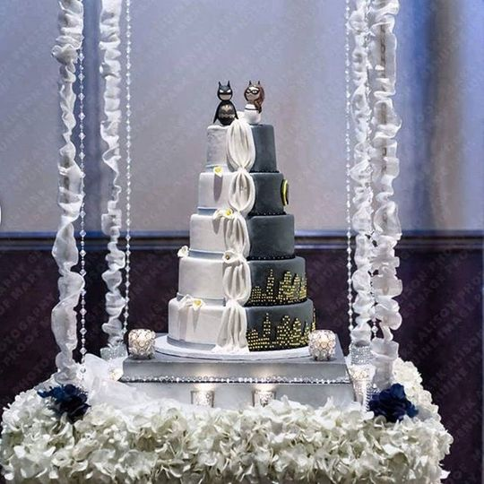 2 sided wedding cake on swing