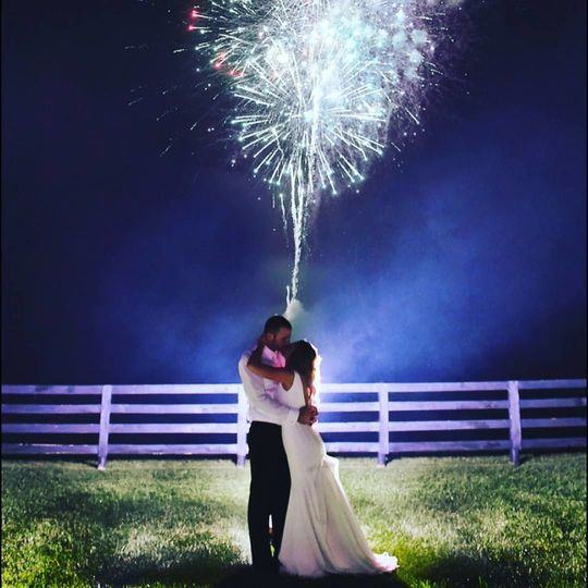 Romantic kissing under fireworks
