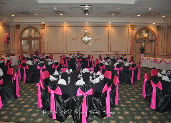 Black chair covers with pink bows