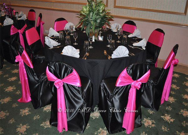 Black table and chairs with pink bows