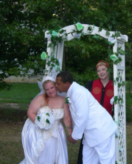 Look how groom, Marcus, steals a kiss from his new wife, Cristy.