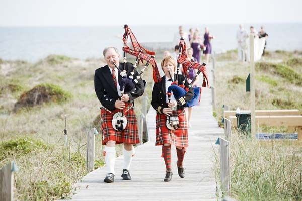 Bagpipes leading the wedding party to the wedding!