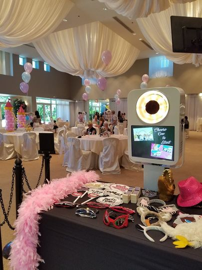 Our new open air photo booth set up with lots of fun props for guests to use.