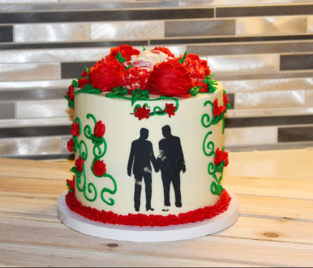 Red and white wedding cake with silhouette