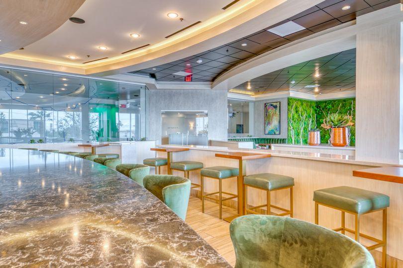 Art Houz Restaurant  with green chairs