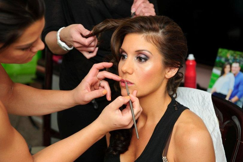 Our Bride getting her makeup done by Skyler for the big day!