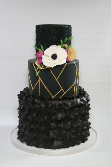 Black wedding cake with gold details