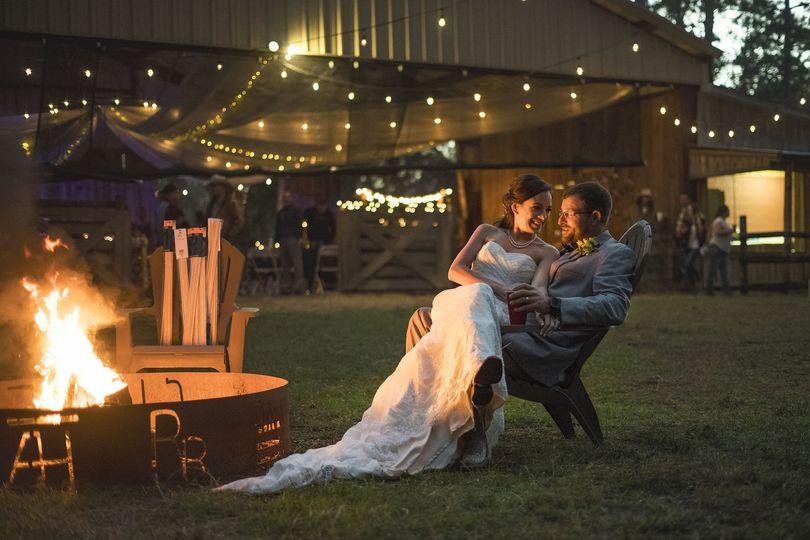 Punta Gorda, FL rustic winter wedding photo near a bonfire.