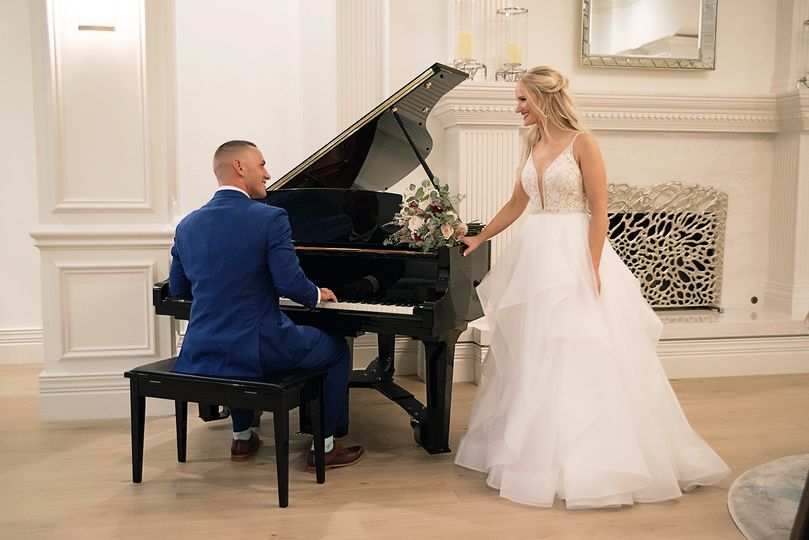 Bride and groom at piano