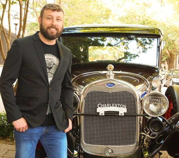 With the vintage car