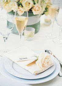 This design includes a plan white polyester table linen. Glam look for less!
