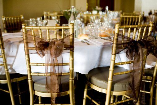 This design includes Mirror Organza sashes to compliment the venues white poly linens.