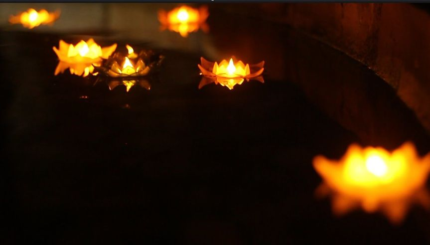 Flower candles in water