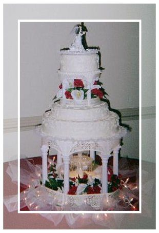 a wedding cake with lights and a fountain