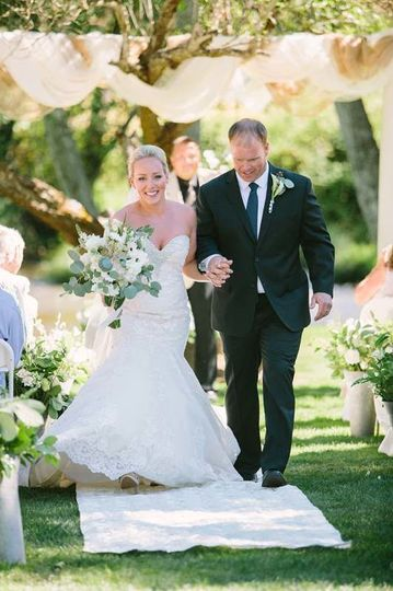 The bride and groom walking down the aisle   Photo by Lahna Marie Photography
