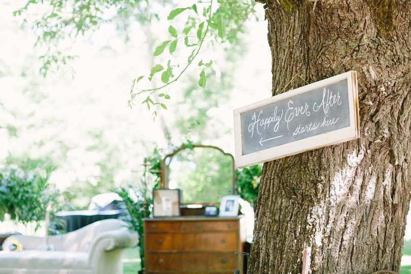 Vintage furniture for a photo table of the bride & groom   Photo by Lahna Marie Photography