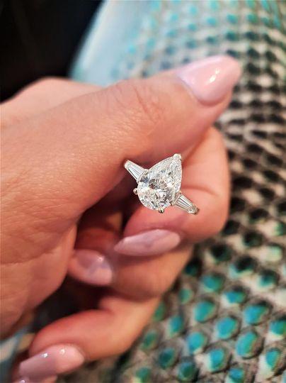 Pear cut three diamond ring