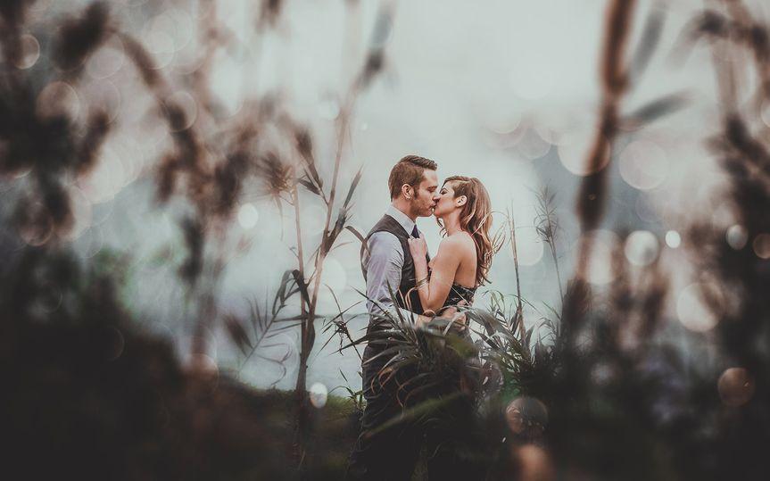 sunset cliffs san diego rainy bokeh kiss bridal po