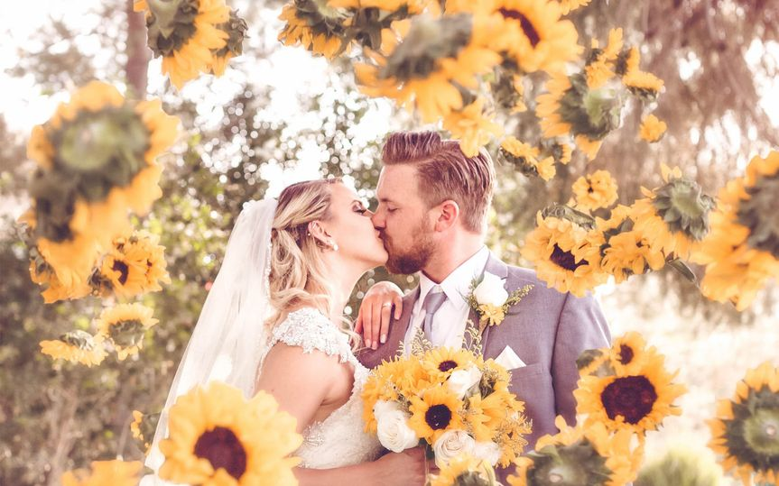 6d4c248ba0567b46 1435702755435 wedding portrait sunflowers flying bokeh jimmy b