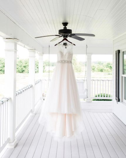 She dreamed of seeing her wedding gown hanging on her Daddy's front porch at her family farm. It was...