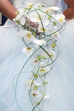 Unique bridal bouquet with phalaenopsis orchids blossoms hand wired to wire cage with rhinestone...