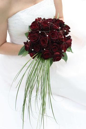 Unique bouquet featuring black magic roses, bear grass with rhinestone & silver wire accents.