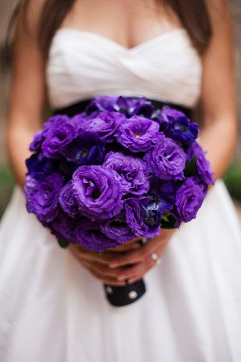 Beautiful structured bouquet featuring rich purple lisianthus and purple ranunculus.