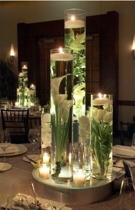 Three cylinders at varied heights with your choice of fully submerged fresh flowers magnified...