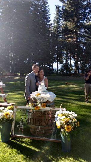 Wedding couple and their cake