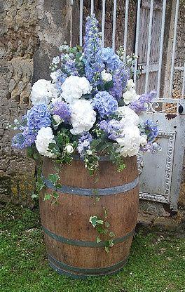 barrel with blue floral arrangement